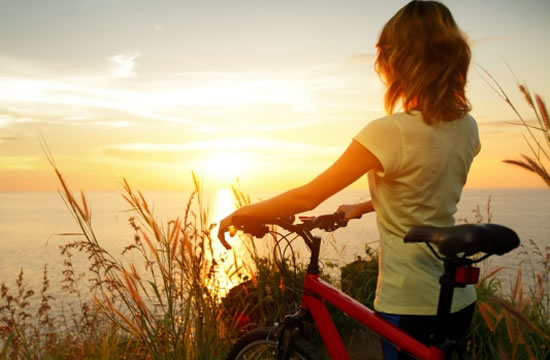 Woman Cycling at Sunset
